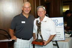 Michael Long, Chief Development Officer of the Broward Partnership presenting Michael Keeby, Regional President, Brown & Brown of Florida and board member of the Broward Partnership with the trophy for the Company Raising the Most Funds for the 8th Annual Broward Partnership Golf Challenge.