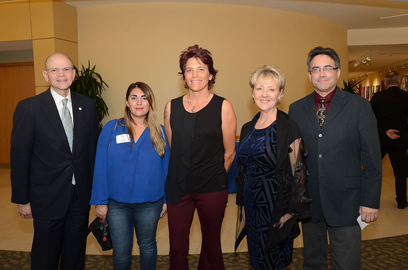 "Holy Cross Hospital President and CEO Patrick A. Taylor, MD, ArtServe Artist Relations Manager and ""Femme in Depth"" Curator Sophie Bonet, ""Femme in Depth"" featured artist Niki Gilmore, Holy Cross Hospital Director of Development Marcie Hall, ArtServe General Manager Hal Axler . Photos courtesy of Holy Cross Hospital"