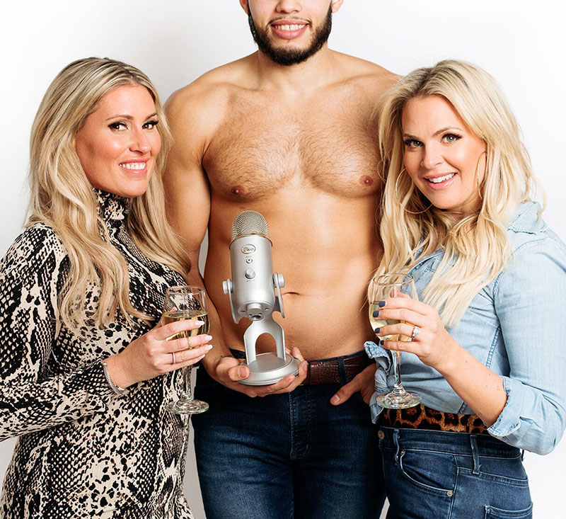 Two women and a topless man.