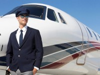 Young Pilot standing by a private airplane